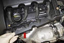 Unclip and remove the wiring harness cover (red arrow) from the valve cover.