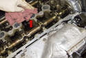 Clean the cylinder head sealing surface (red arrow).