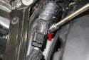 Boost sensor: Using a 8mm socket, remove the sensor fastener (red arrow).