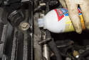 Once the residue has been reduced to only a thin coating, pour in a top engine cleaner.
