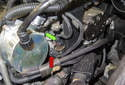 Disconnect the electrical connectors for the oil pressure sensor (red arrow) and the coolant temperature sensor housing (green arrow).