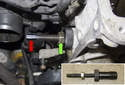 Install the timing chain pre-tensioner tool 11 9 340 with the seal from the tensioner (inset).