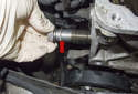 Remove the timing chain tensioner (red arrow).