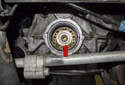 Note that the oil pump sprocket stays in place (red arrow).