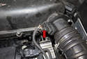 The mass air flow sensor (red arrow) is located at the air filter housing (red arrow) outlet on the left side of the engine.