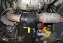 With the exhaust moved backward (red arrow), you now have access to the engine oil pan (yellow arrow).