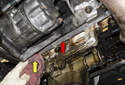 Thoroughly clean the engine crankcase-sealing surface (red arrow).