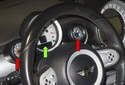 The tachometer (green arrow) on MINI R56 models is serviced as a whole unit.