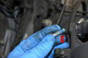 The retaining bolts are micro encapsulated (red arrow) from the factory and are considered single use only hardware from Mini.