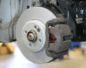 Install the caliper over the new pads and onto the caliper mount.