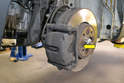 With the wheel off you can see the brake caliper, the rotor and the two brake pads.