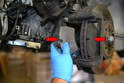You should be able to pull the pads out from the mounting bracket with your hands (red arrows).