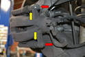 There are two 13mm retaining bolts (red arrows) and two 15mm guide bolts that the retaining bolts bolt into (yellow arrows).