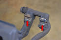 Before installing the new pads take a moment and clean the metal clips on the caliper mount where the brake pads sit (red arrows).