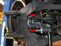 Use a 16mm socket and remove the two caliper mount bolts (red arrows).