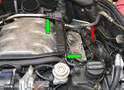 Remove the EGR purge valve line (green arrow) from atop the driver's side fuel rail.