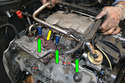 Pull the fuel rail and injectors up and out of their holes in the manifold (green arrows).