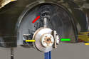 You are going to be removing the caliper (green arrow), rotor (yellow arrow) and compressing the spring (red arrow).