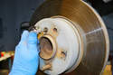 Use an Allen key and remove the securing screw holding the rotor to the hub.
