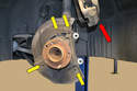Remove the four 8mm nuts (yellow arrows) holding the dust shield on and set the dust shield aside.