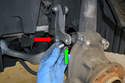 Use and 18mm socket and remove the pinch bolt (red arrow) and a 16mm to remove the stabilizer link bolt (green arrow).