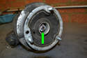 The upper strut nut (green arrow) is recessed and BMW recommends you do not use an impact tool to remove it.