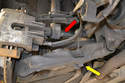 This photo illustrates the two fasteners you need to remove under the vehicle.