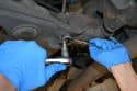 Remove the stabilizer link from the sway arm using a T40 Torx and an 18mm wrench.
