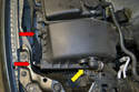 Unplug the breather hose (yellow arrow) going in to the side of the air box cover, squeeze it together and pull it off.