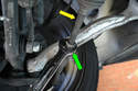 Use a 21mm wrench and loosen the nut on the steering rack (green arrow) back towards the rack itself, then using a 15mm wrench turn the rod on the steering rack (yellow arrow) until it unscrews itself from the tie rod.