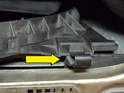 Remove the clip holding the shroud on the driver side (yellow arrow); pull the shroud up and out of the engine compartment.
