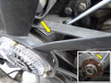 Place the Mercedes-Benz tool # 103-0040 (yellow arrow) in between the grooves on the housing and slowly rotate the fan until the tool engages the hole in the back of the pulley.