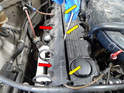 Remove the plastic cover that the spark plug wires and a vacuum line sit in.