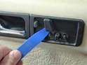Using your trim tool remove the plastic pieces for the seat controls.