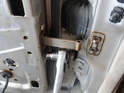 Open the door (careful not to let it fly open) and remove the three 10mm bolts holding the stay unit to the inner door.