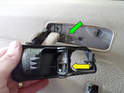 After the handle unit has been pulled forward, reach in and remove the actuator rod (green arrow) from the handle (yellow arrow).