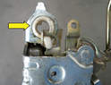 This Teflon bushing (yellow arrow) is a weak spot in the latch and can rip, weaken or just wear out.