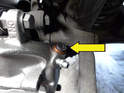 Remove the rubber plug from the new caliper to install the brake line (yellow arrow).