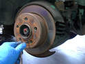 There is a small locator screw that holds the brake disc in place.