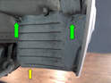 To remove the fender liner you will need to unscrew the two 8mm nuts (green arrow) and the one Phillips-head screw (yellow arrow, not shown).
