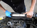Wiggle the radiator from its lower mounts and pull straight up and out of the car.