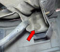 Remove the 10mm bolt that holds bumper to the outside support.