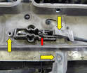 On the underside of the cross mount you need to disconnect the hood latch cable (red arrow).