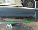 Remove the tow hook cover on the lower passenger side of the bumper.