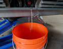 Flush the system by placing a garden hose in the reservoir and running tap water through the system.