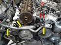 Remove the heater line that runs across the front of the engine to the water pump (yellow arrows).
