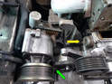 To get access to the chain tensioner (yellow arrow) you will need to move the smog pump out of the way.