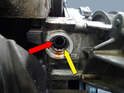 Next use a 17 mm Torx and unscrew the threaded ring inside the housing (yellow arrow).