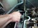 Undo the bolt for the automatic transmission tube from the back of the head.