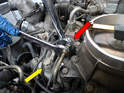 Open the gas cap to relieve some pressure and separate the fuel lines (red arrow, one fuel line shown).